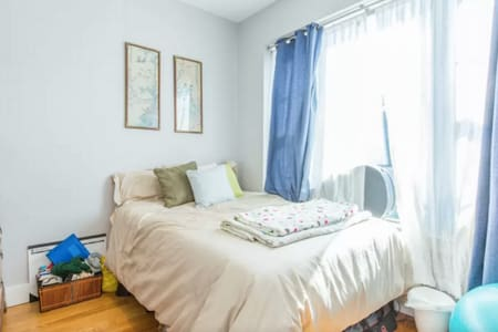This room features large windows and a full-sized bed. Located in a brand new apartment in the trendy Bushwick area, it's a 15 minute subway ride to Williamsburg or 20 to downtown Manhattan. Bars, restaurants, and coffee shops minutes away!