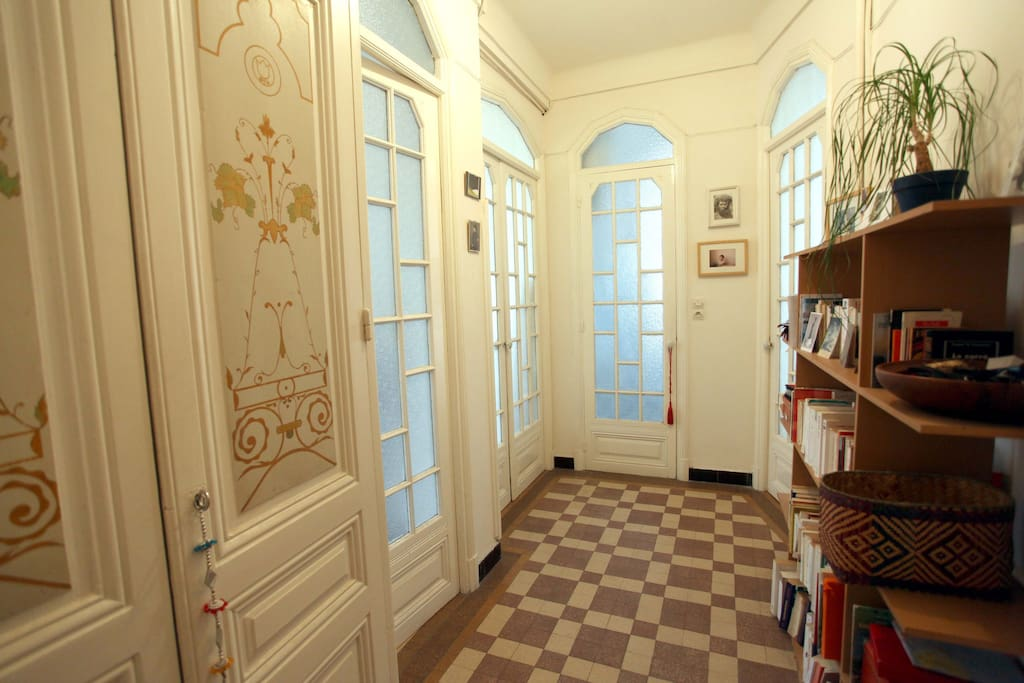 Book shelves with English and French books. Tiles have been changed