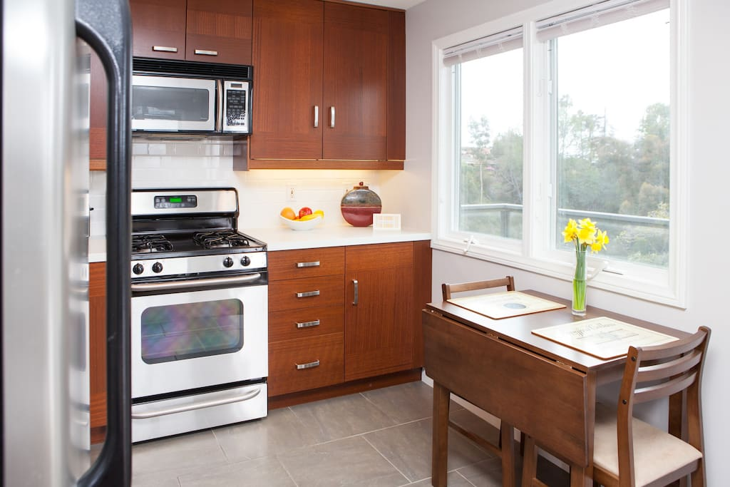 full sized kitchen; stocked with dishes, cooking supplies, and always a selection of  snacks and light food