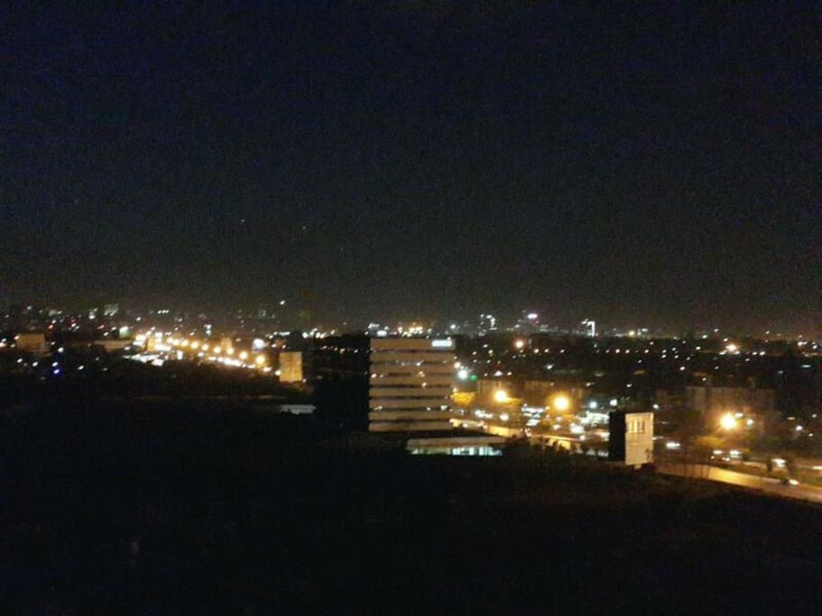 City Lights - View of the city from the balcony at night...
