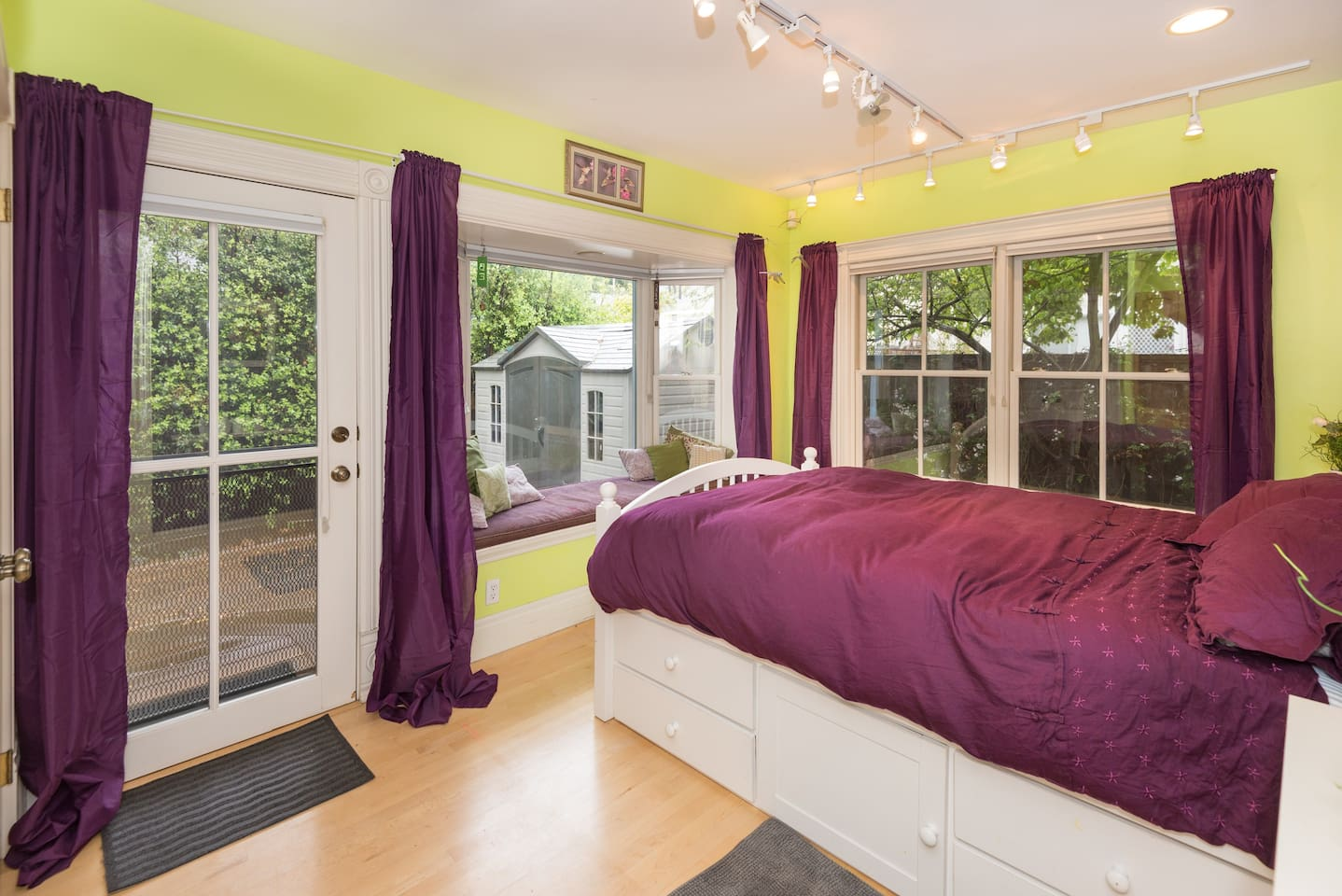 Bright and airy garden room with separate entrance, bay window seat, and lots of storage.