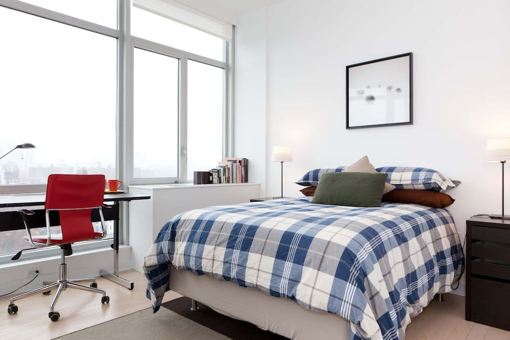 Your bedroom, with a full size bed, memory foam mattress, and a view on Manhattan