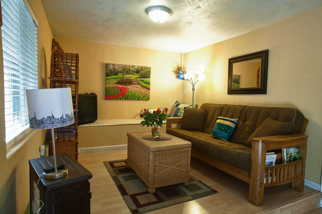 Living room with pull out queen futon couch/bed, frieplace, flat screen tv (new)