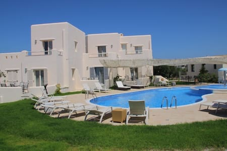 Naxos,next to the superb Agios Prokopis beach only 3 km from the port,you will find a lovely complex of 7villas ready to offer you a relaxing stay during your vacations. Newly constructed in the traditional  style of the Cyclades, with swimming pool.