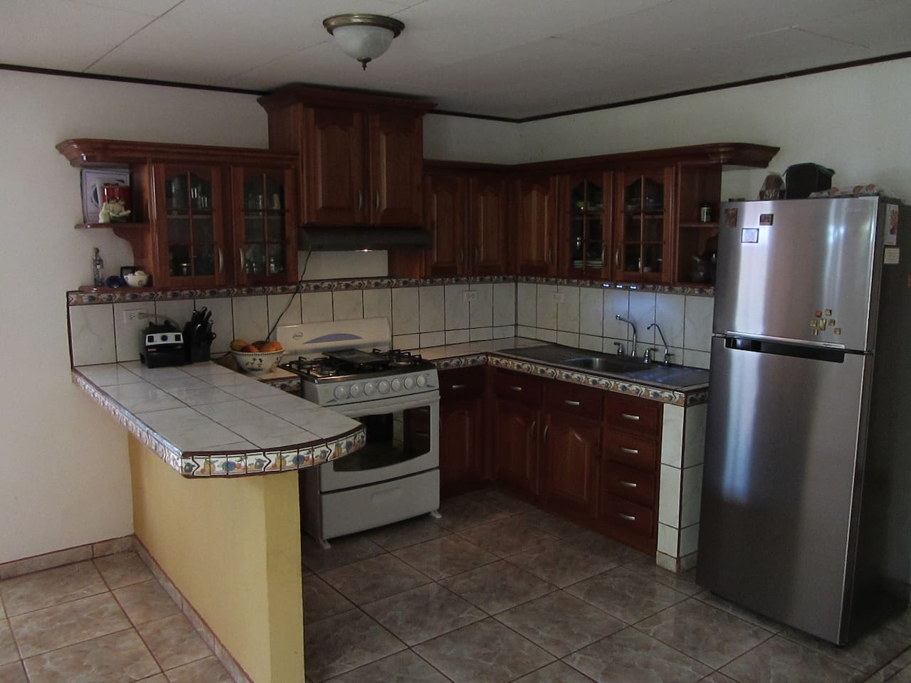 Our kitchen is very well equipped with new appliances, plenty of counter-tops and cabinetry for storage.