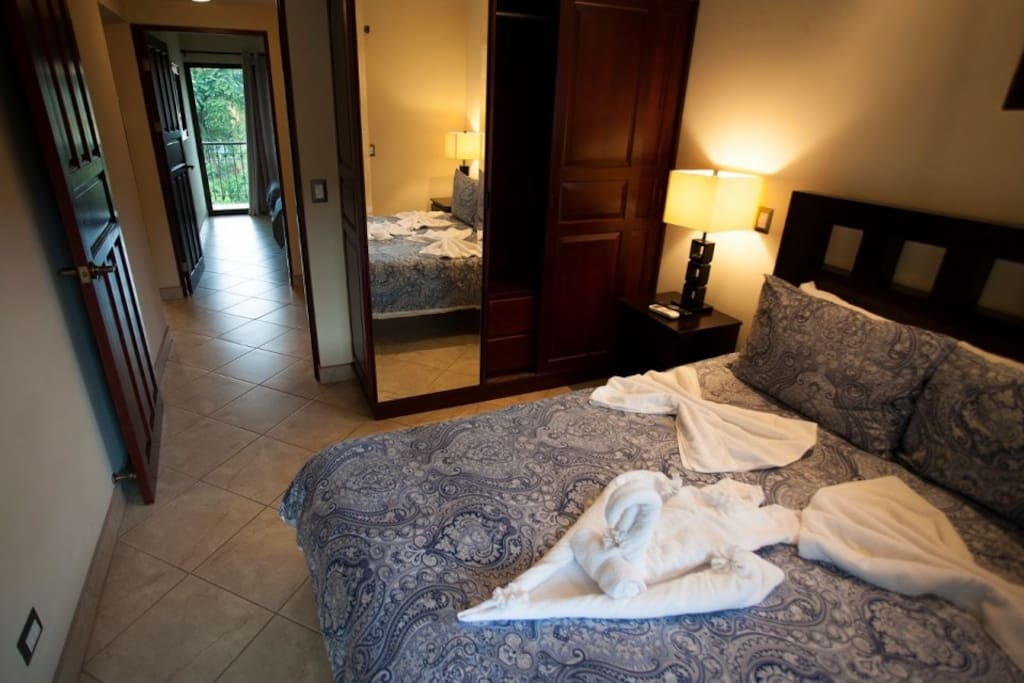 King size bed with  bathroom and private balcony