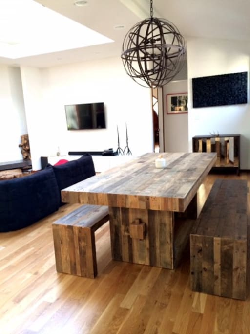 Reclaimed wood table and benches seats 8