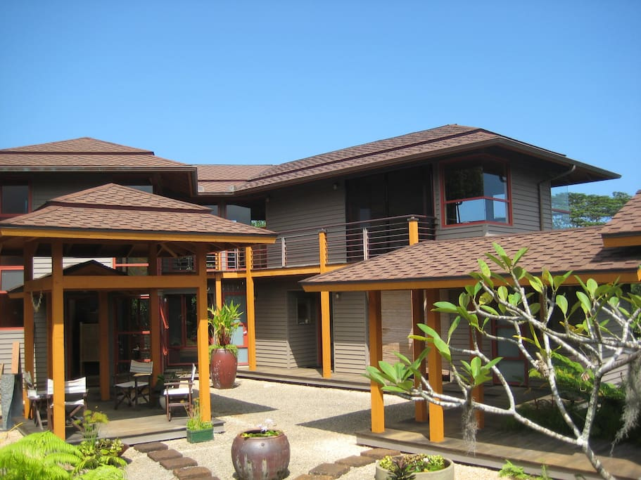 Overall private courtyard entry through balinese style gate