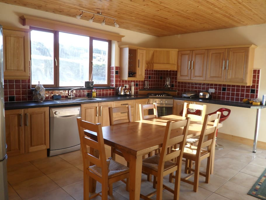 Large oak kitchen with seating for 8 people