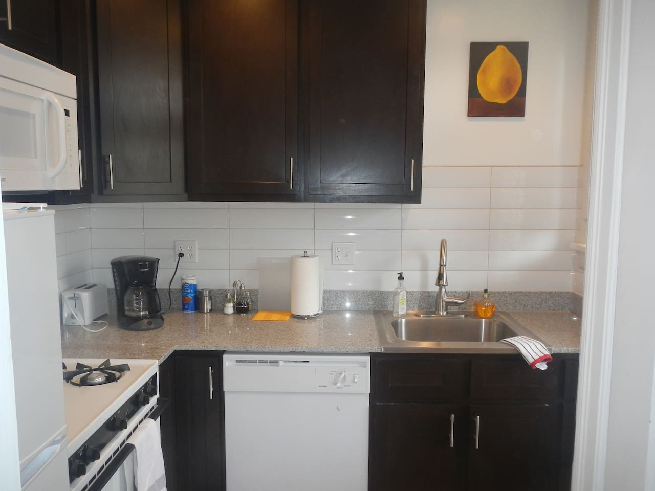 Modern kitchen with granite counters and dishwasher