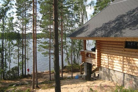 Log Cabin beside lake and forest - Rautalampi