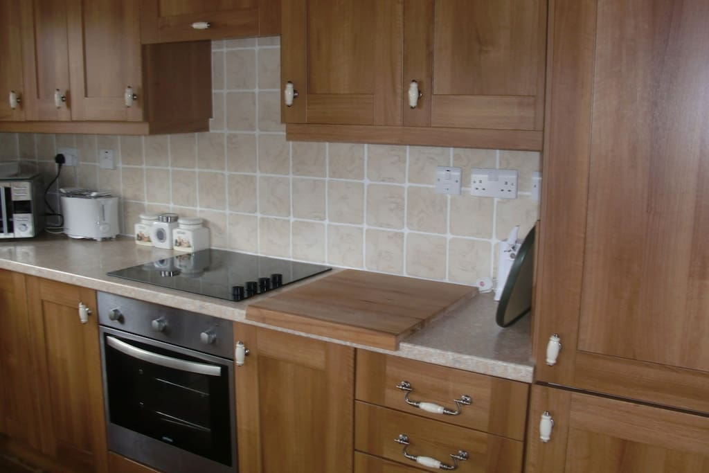 The kitchen has a halogen hob and oven, toaster, microwave, fridge freezer. The cupboards are fully equipped.