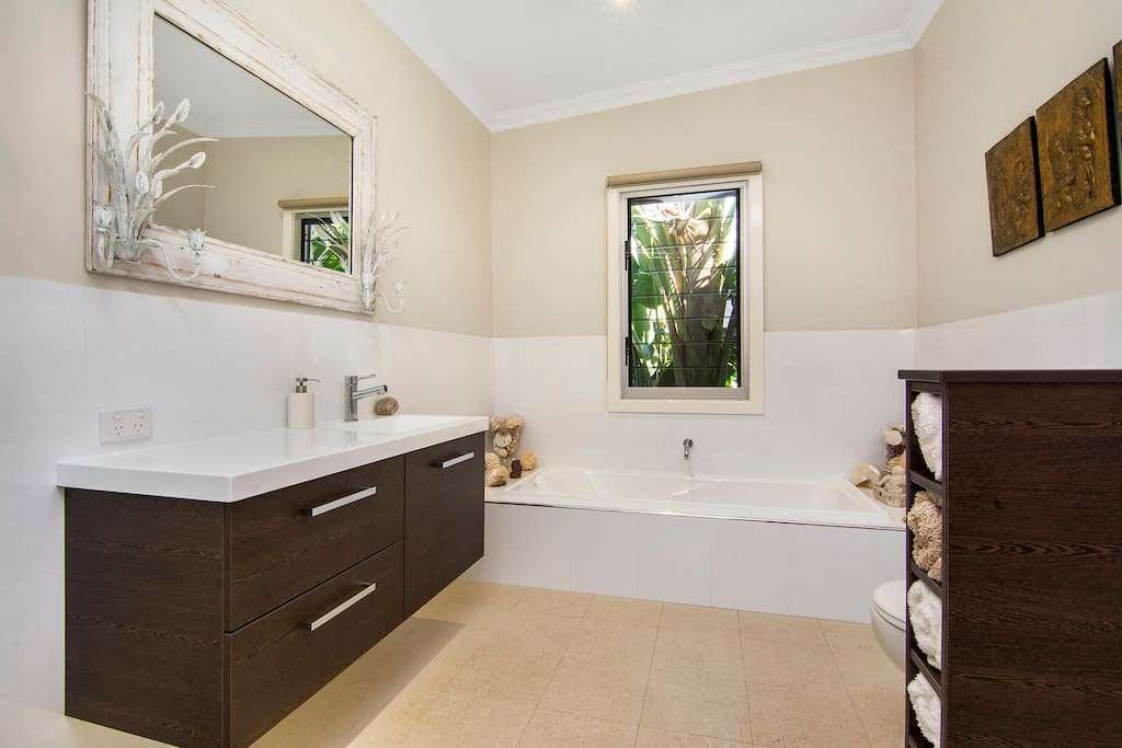 Lovely bathroom with large shower plus toilet.