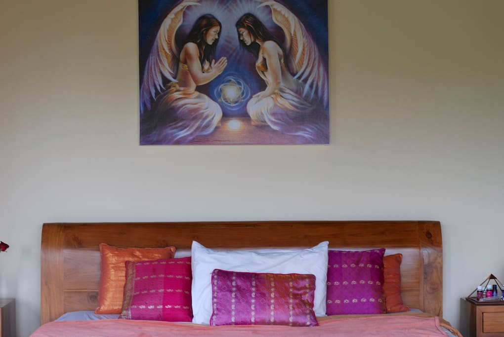 the master suite of the house! massive king size bed, air-con, beautiful angel painting, side tables with soft lighting, wardrobe
