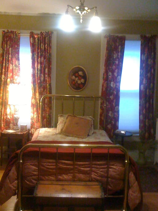 The Gold Room, has a queen- size bed, desk, bureau & closet.