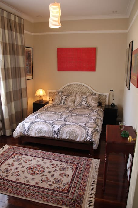 Private bedroom with very comfortable queen size bed. Closet with hanging space and drawers.