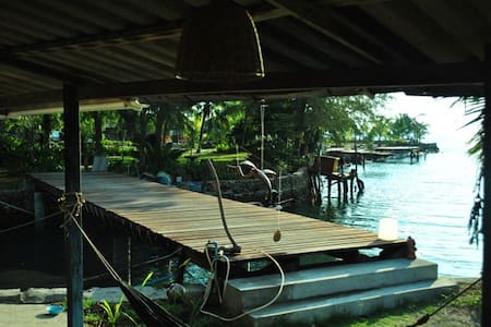 Stilt house between sea and river - House
