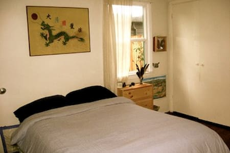Large sunny bedroom with easy access to bathroom down the hall.