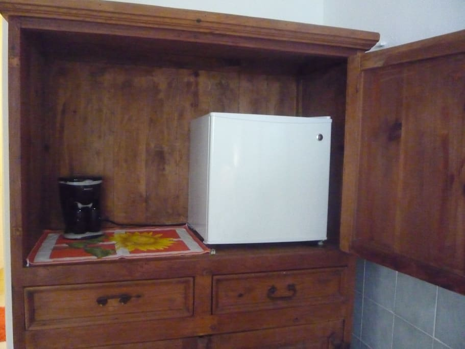 coffee maker and minifridge in the bedroom