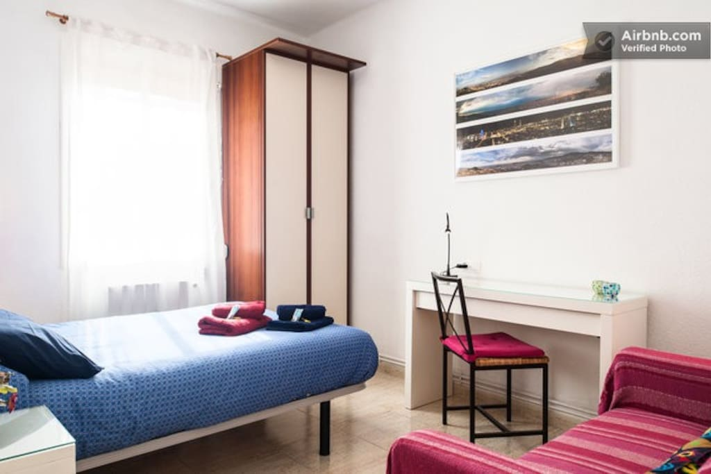 Bright spacious room with big sized double bed, big cupboard, sofa and desk. Decorated with panoramic Barcelona views. Towels and sheets provided.