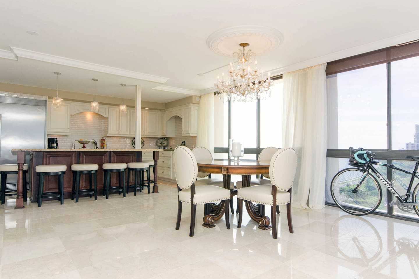 Marble floors and crystal lighting fixtures adorn the great room.