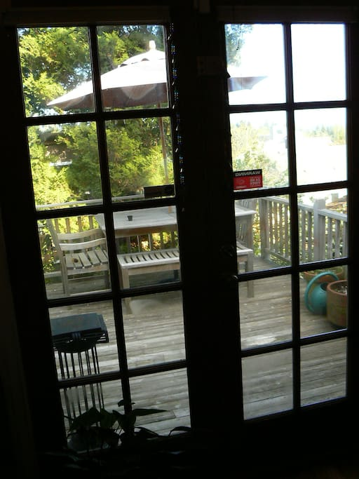 French doors in guest room out to deck.  Has table, swing and new grill with view of the Cascades.