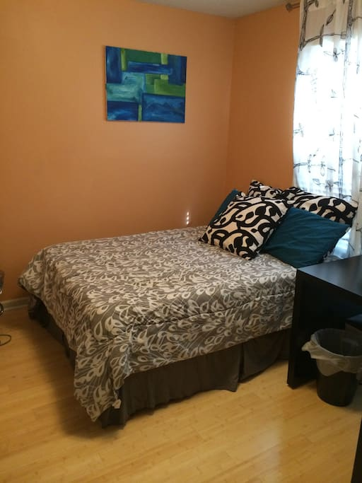 Guest room. There is a full sized mattress, and also a new bedframe with headboard!