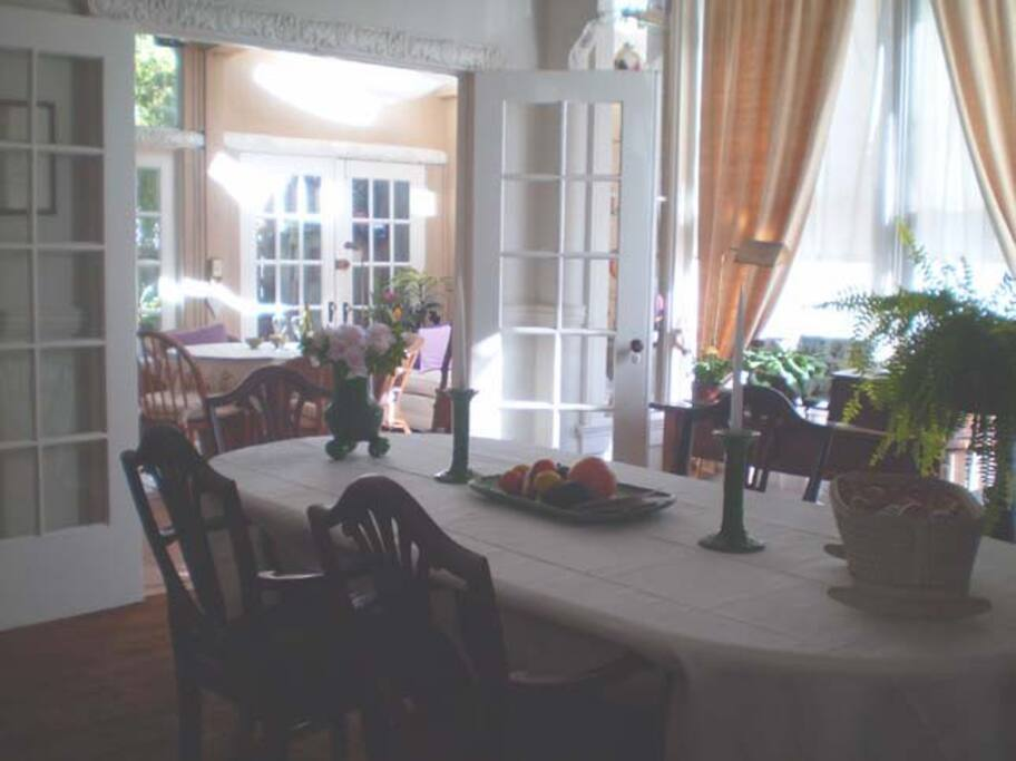 Dining room with French Doors leading to sun room