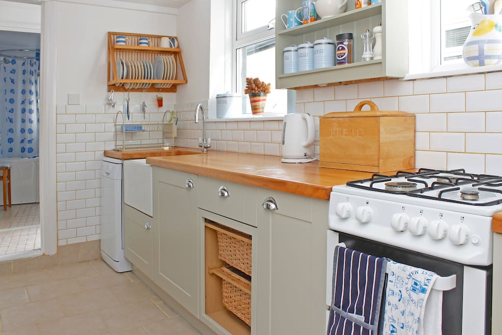 Kitchen - oven, hob, dishwasher, kettle, toaster, fridge and sink.