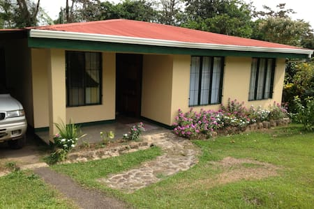 Private room in comfortable home in quiet Costa Rican neighborhood.  Beautiful garden in back, complete with fruit trees.  Easy walk to town for access to shopping, banking and restaurants and not far from the entrance to the Tenorio National Park.