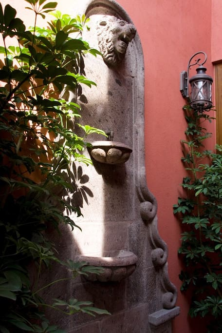 Carved stone fountain in the entry