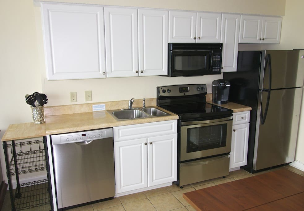 BRAND NEW stainless appliances and a handy cart for extra work space.