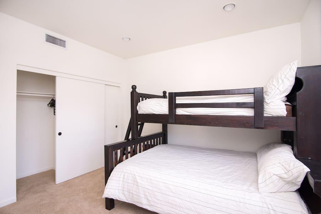 2nd bedroom. Bunk beds, queen bottom twin on top.