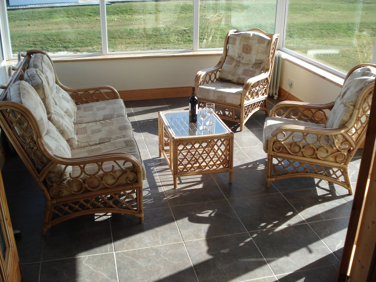 Relax in the sunroom which leads onto South facing patio