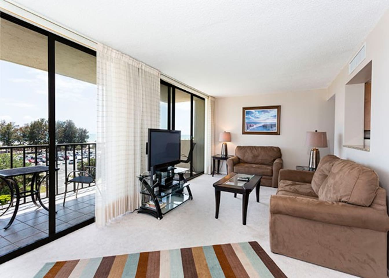 You'll never want to leave the cozy, plush couches! Recently refurnished, the spacious living room was designed with comfort, style, and relaxation in mind. The room is very light and airy because of the ceiling to floor windows leading to the balcony!