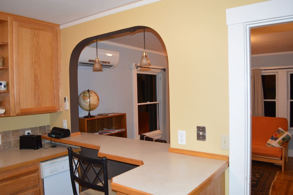 0 -. The kitchen area is open to the front room and allows for seating on both sides of the bar.