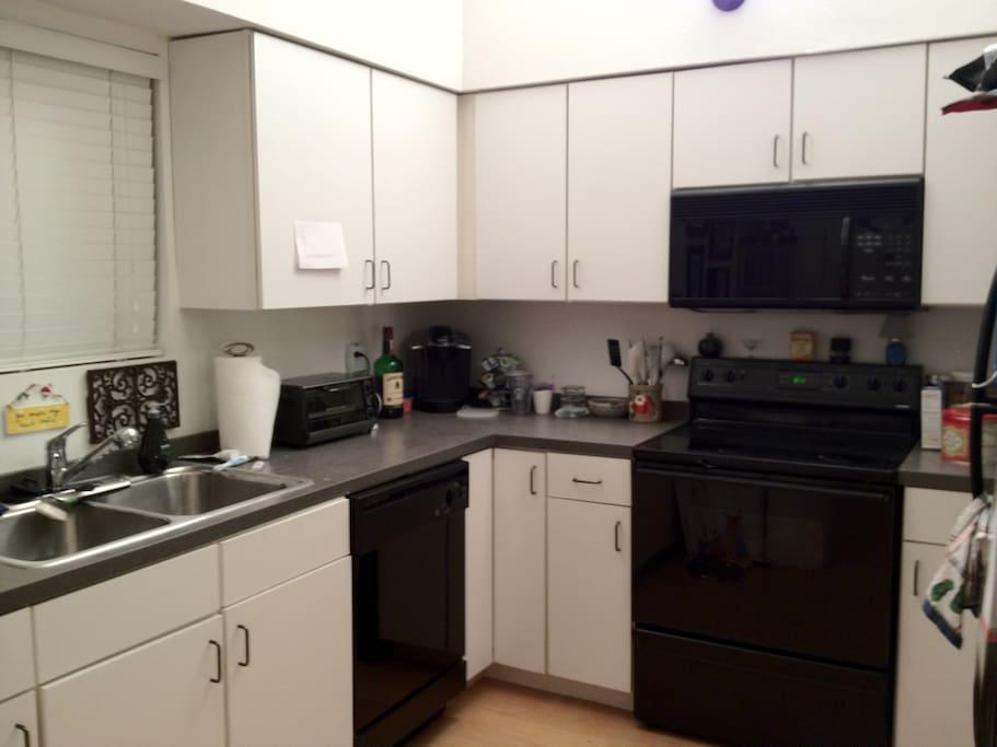 Kitchen: Toaster, Keurig, microwave, stove, range, and fridge