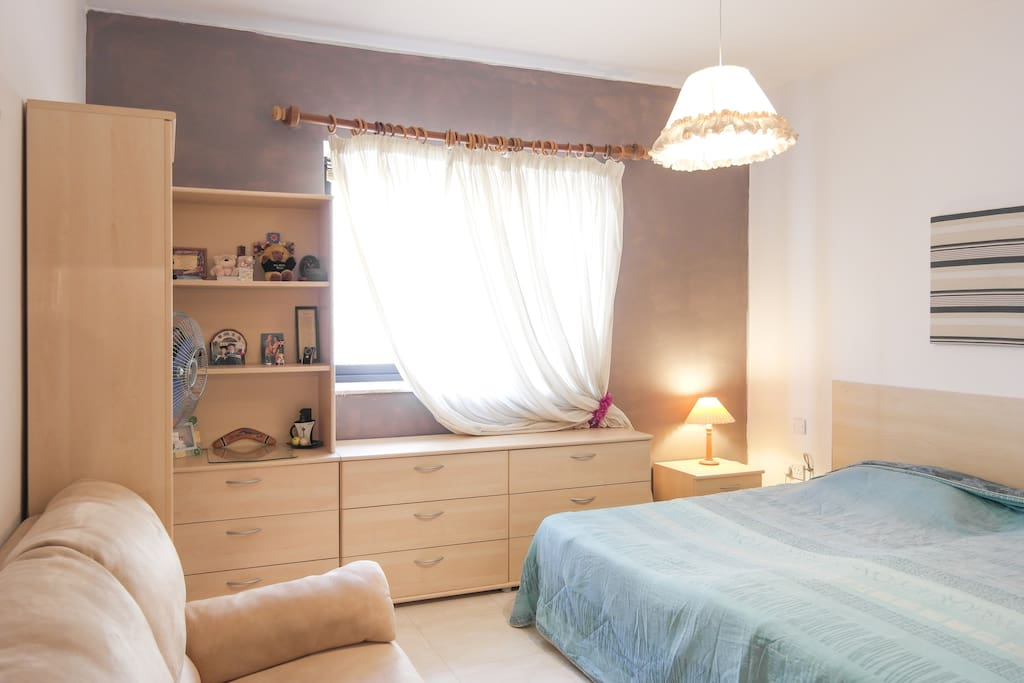 2single beds bedroom, with AC and sofa.
