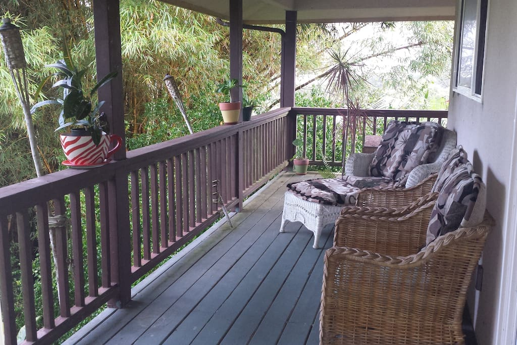 The balcony overlooking trees and bamboo