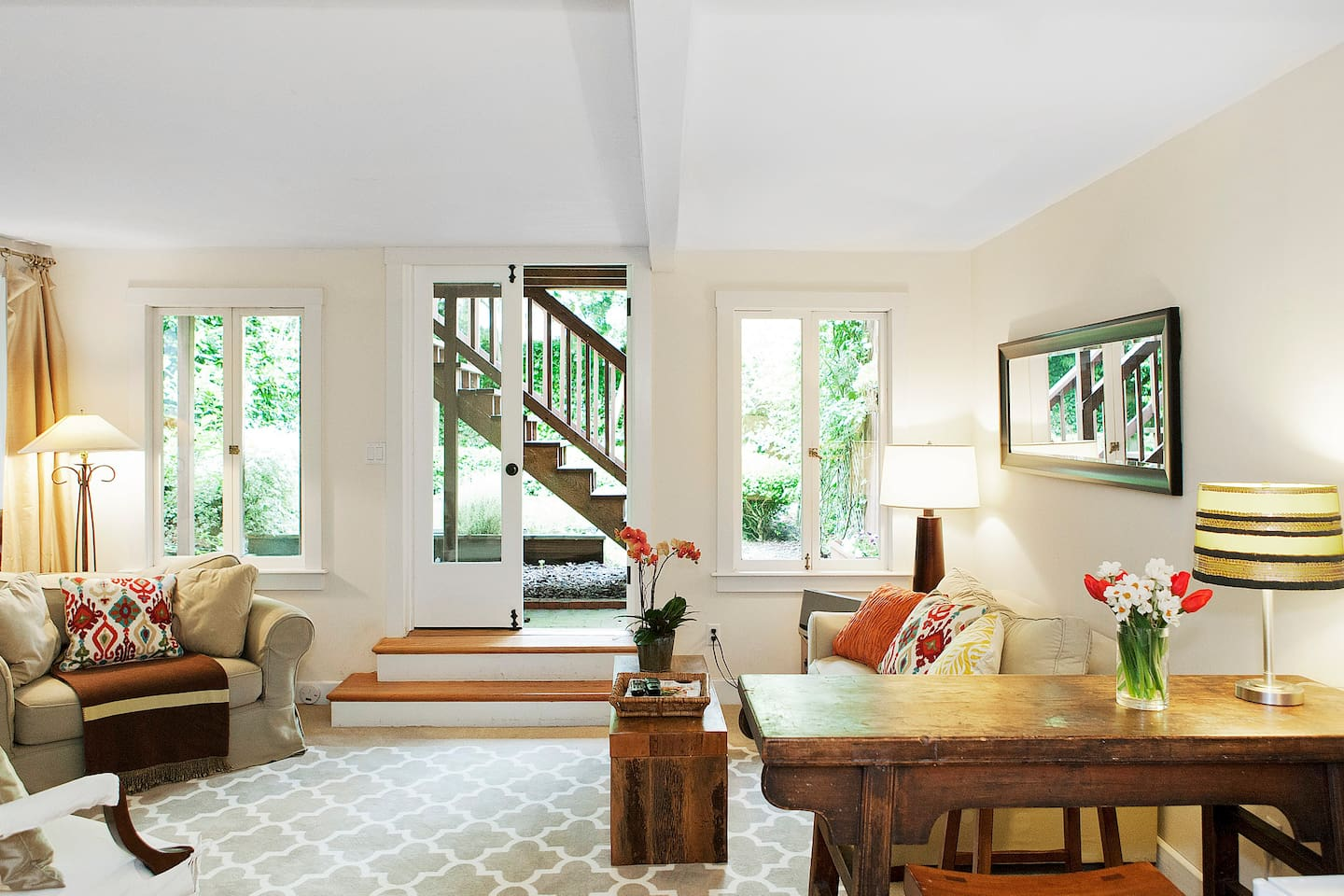 Enter through french doors to a light filled living room
