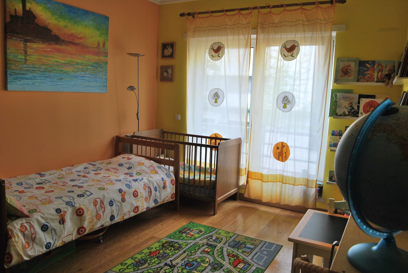 Children's room has a baby/toddler bed and a single bed for an older child or an adult.