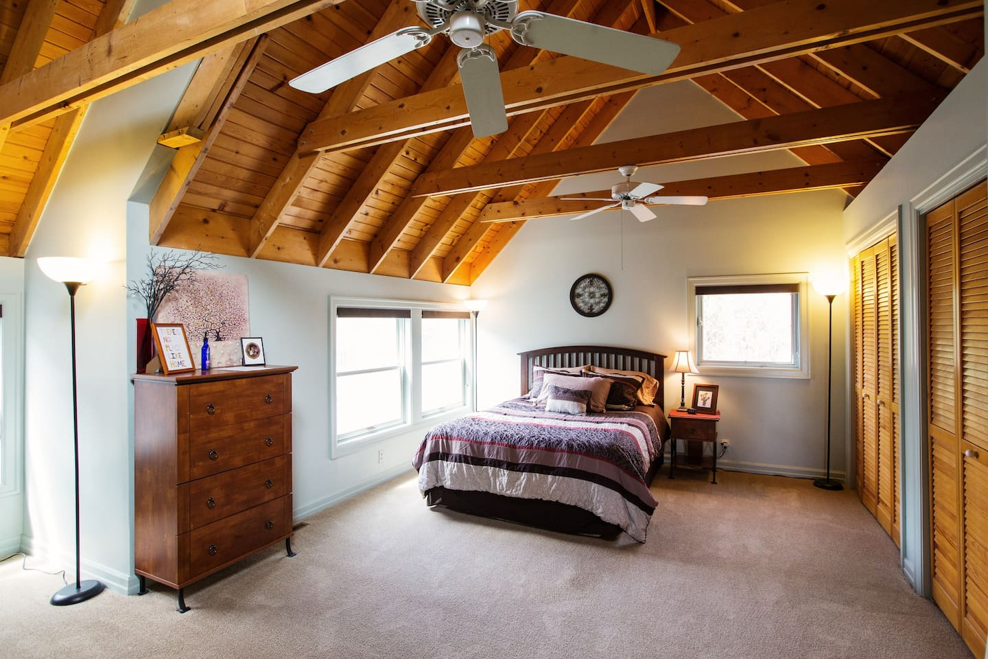 Guestroom 1:  Queen bed, ample closet space, couch, dresser,  vaulted ceiling, lots of light.