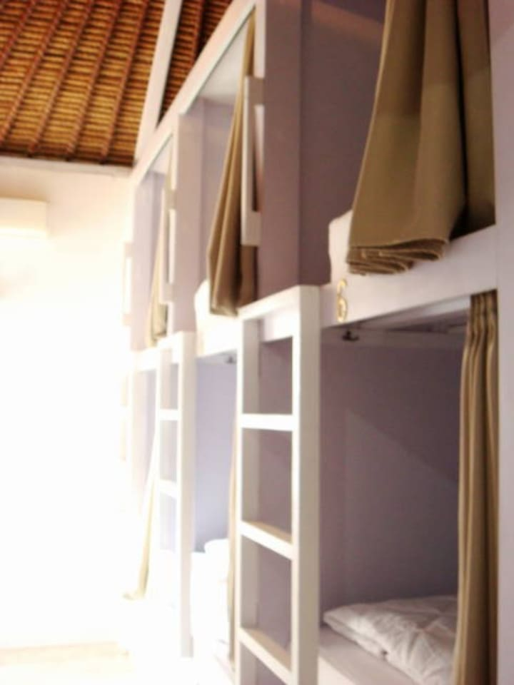 Eight bunk beds in this minimalist dorm room