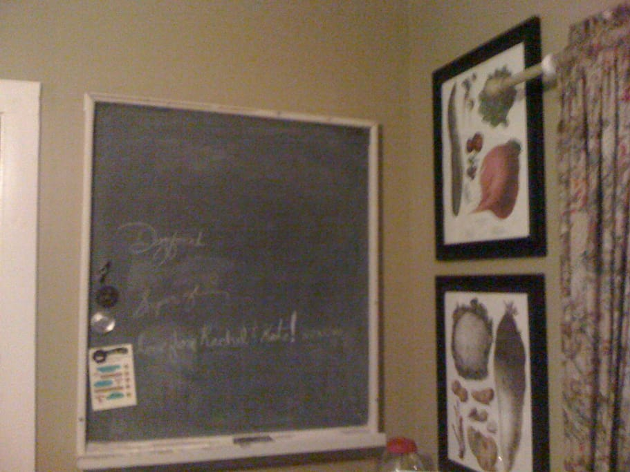 Our message center in the kitchen, pure slate old chalkboard from Old Main at the Univ of Arkansas