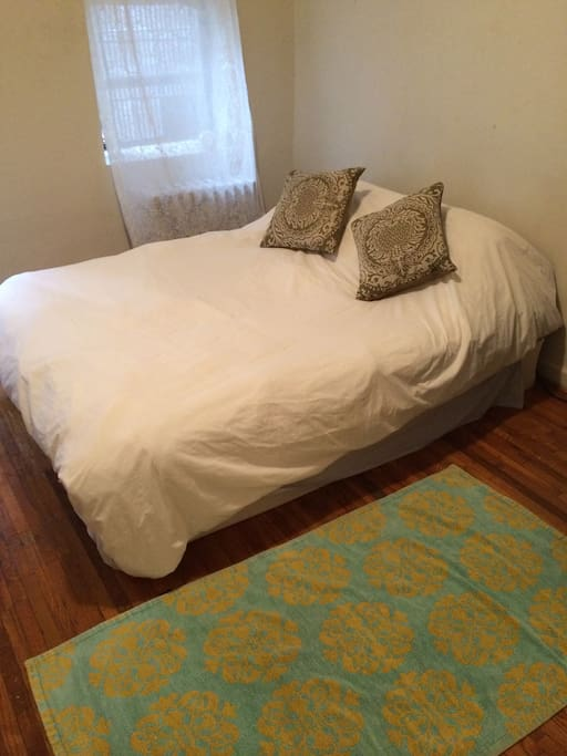Comfortable bedroom with a down comforter.