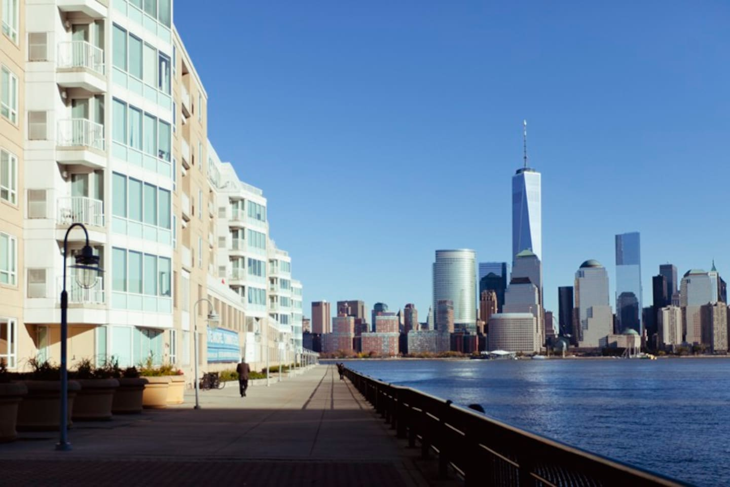 Building Exterior and Riverfront Promenade with Views of New York City