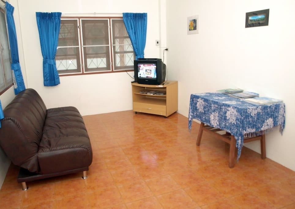 "The main room of the house includes a TV (now replaced by a newer 32"" flat screen LCD) with cable,  DVD/CD/MP3 player, brand new curtains with blackout backing for the utmost in privacy."
