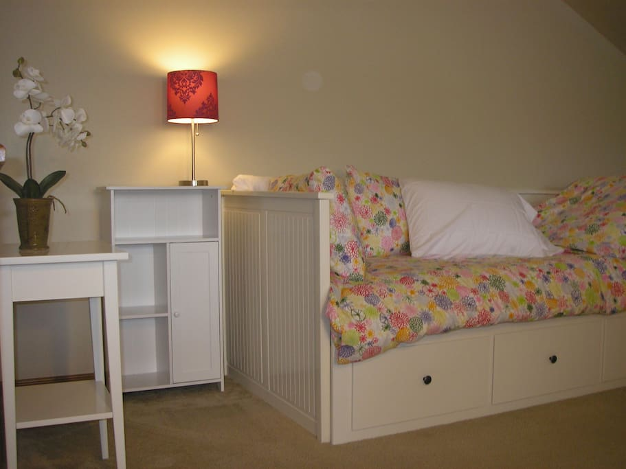 Daybed, also in upstaris loft, opens to sleep two - perfect for the kids!