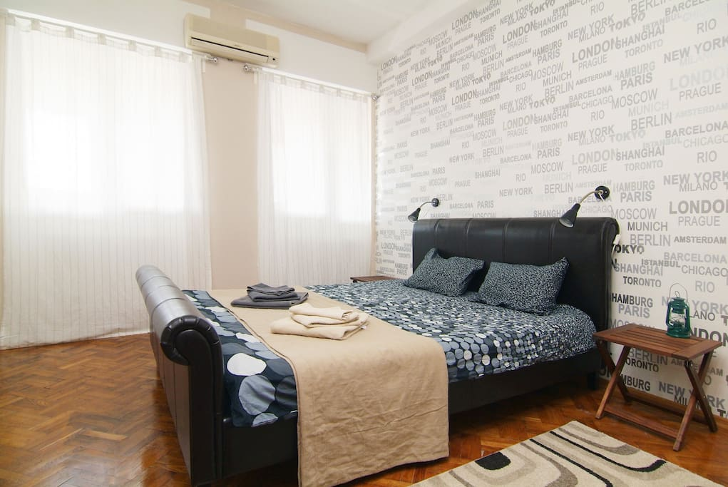 Elegant  double bed Room with 3 large windows,  with closable rolling shutters