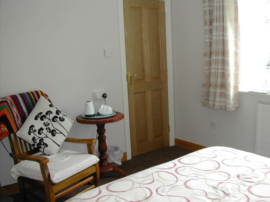 Seating area in our deluxe bedroom with tea/coffee